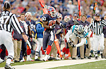 Buffalo Bills wide receiver Eric Moulds (80) eludes a tackle from safety Marlon McCree (27) to find additional yardage against the Carolina Panthers on November 27, 2005 at Ralph Wilson Stadium in Orchard Park, NY. The Panthers defeated the Bills 13-9. Mandatory Photo Credit: Ed Wolfstein