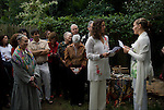 Leigh and Helena reading, pledging their vows to each other at the Sacred Union  Celebration in the back yard of friends<br /> <br /> Release # 2528