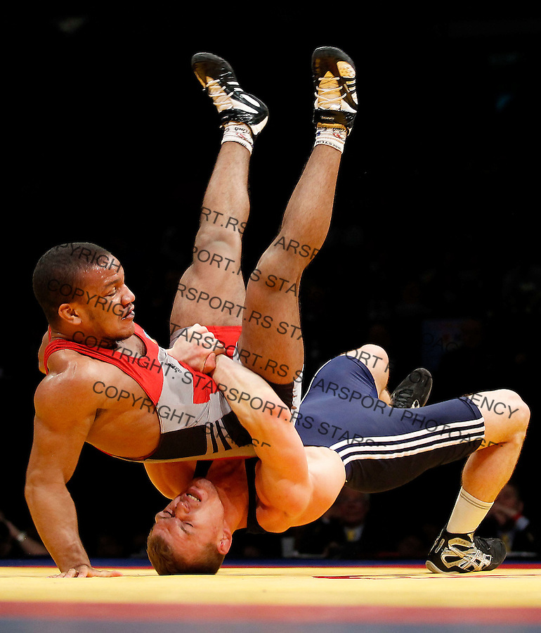 BELGRADE, SERBIA - MARCH 11: Zhan Bleniuk of Ukraine (TOP) fights with Laimutis Adomaitis of Lithuania (DOWN) during bronze medal Men's Greco-Roman 66kg style match at the European wrestling championship March 11, 2011 in Belgrade, Serbia.(Photo by Srdjan Stevanovic/Getty Images)