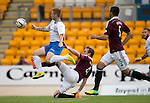 St Johnstone v Hearts...03.08.14  Steven Anderson Testimonial<br /> Liam Caddis is tackled by Danny Wilson<br /> Picture by Graeme Hart.<br /> Copyright Perthshire Picture Agency<br /> Tel: 01738 623350  Mobile: 07990 594431
