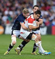Yu Tamura of Japan is double-tackled. Rugby World Cup Pool B match between Scotland and Japan on September 23, 2015 at Kingsholm Stadium in Gloucester, England. Photo by: Patrick Khachfe / Onside Images