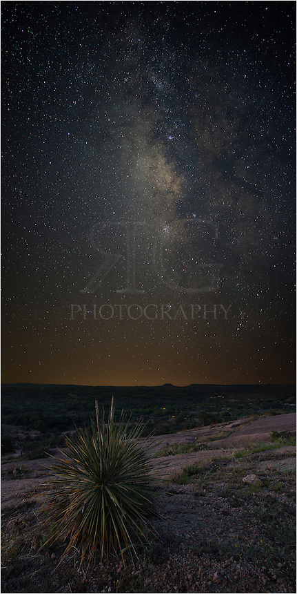 I trekked out to Enchanted Rock State Park in the Texas Hill Country knowing the three-quarters moon would be setting about 4:00am. Shortly after moonset, I photographed first the vast Milky Way, the took some images of the foreground. Back home, I merged several images together to form this vertical panorama of the Milky Way over a yucca plant.