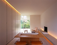 A wall of cupboards conceals all signs of everyday life in this minimal living room