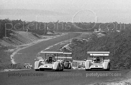 Pace lap of 1969 Bridgehampton Can-Am, with Bruce McLaren on pole in McLaren M8B no. 4 alongside team mate Denny Hulme (5); PHOTO BY Pete Lyons 1969 / © 2014 Pete Lyons/www.petelyons.com;
