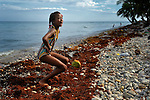 """Doris Prevost, a member of Nouvel Etwal - Haitian Kreyol for """"New Stars"""" - dances on the beach at Jacmel, Haiti. Nouvel Etwal is a dance and creative movement group of 16 girls from age 8 to 13, based in the southern village of Mizak. According to Valerie Mossman-Celestin, an organizer of the group, """"Nouvel Etwal seeks to empowers girls to be self-confident and creative. The girls learn flexibility, discipline and teamwork, lessons they also need for life. Nouvel Etwal promotes health, well-being and enhanced self-worth. The girls are encouraged to live into a brighter future where girls and women are valued,  educated, and have equal opportunity to achieve their potential."""""""