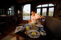 January 29th, 2008_Kerala State, India_ Breakfast is served on a luxury boathouse, as it cruises an area of the backwaters which is located in the Southern Indian state of Kerala.  The waterways are a signature attraction in Kerala and are also an important link for communities and commerce there.  Photographer: Daniel J. Groshong/Tayo Photo Group