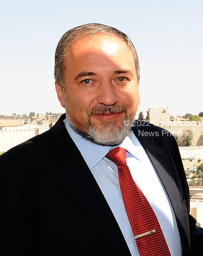 Minister of Foreign Affairs and Deputy Prime Minister of Israel Avigdor Lieberman poses for a photo with United States Secretary of State Hillary Rodham Clinton (not pictured) at the David Citadel Hotel in Jerusalem, Israel, on Wednesday, September 15, 2010. .Credit: Department of State via CNP.