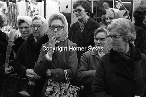 Working class middle aged headscarf wearing at the Roman Road market, East London England 1975
