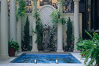 A roof garden is dominated by a swimming pool with a classical theme