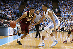18 January 2014: Boston College's Olivier Hanlan (21) and North Carolina's J.P. Tokoto (13). The University of North Carolina Tar Heels played the Boston College Eagles in an NCAA Division I Men's basketball game at the Dean E. Smith Center in Chapel Hill, North Carolina. UNC won the game 82-71.