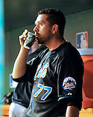 New York Mets manager D.J Carrasco (77) enjoys a drink after shutting down the Washington Nationals eighth inning rally at Nationals Park in Washington, D.C. on Friday, July 29, 2011.  The Mets won the game 8 - 5..Credit: Ron Sachs / CNP.(RESTRICTION: NO New York or New Jersey Newspapers or newspapers within a 75 mile radius of New York City)