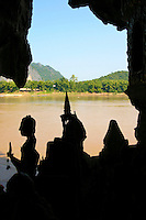 Pak Ou Caves are 25 km from Luang Prabang.  They are a magnificent group of caves that are only accessible by boat.  The caves are noted for their impressive Lao style Buddha sculptures assembled over the centuries by local people and pilgrims. Hundreds of mostly wooden Buddhist figures are laid out over the floors and wall shelves. They take many different positions, including meditation, teaching, peace, rain, and nirvana.
