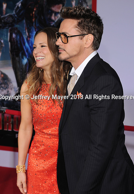 HOLLYWOOD, CA- APRIL 24: Actor Robert Downey Jr. (R) and wife Susan Downey arrive at the 'Iron Man 3' - Los Angeles Premiere at the El Capitan Theatre on April 24, 2013 in Hollywood, California.