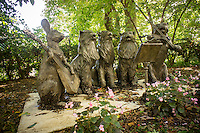 Singing cat band sculpture. Gravestones for owners' beloved pets in the Hartsdale Pet Cemetery in Hartsdale in Westchester County New York State on Sunday, September 22, 2013. The Hartsdale Pet Cemetery is the first pet cemetery in the United States, started in 1896 and incorporated as a cemetery in 1914. Recently the NYS Division of Cemeteries had ordered animal cemeteries in the state to stop the internment of pet owners' ashes with their pets but after the uproar the order was reversed as long as the cemetery was not charging the owners for the human internment. There are approximately 500 people already interned amongst the over 80,000 dogs, cats and other pets.  (© Richard B. Levine)