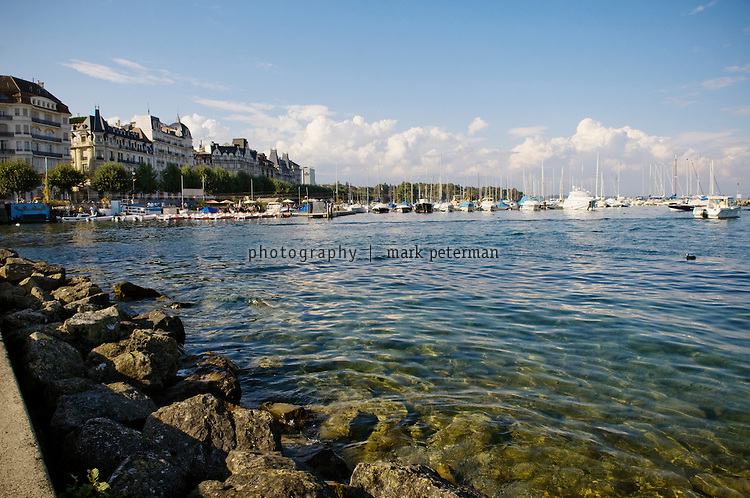 Switzerland where boats line the shore of lake geneva lac leman
