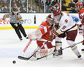 Kieran Millan (BU - 31), Barry Almeida (BC - 9), Adam Clendening (BU - 4) - The Boston College Eagles defeated the Boston University Terriers 3-2 (OT) in their Beanpot opener on Monday, February 7, 2011, at TD Garden in Boston, Massachusetts.