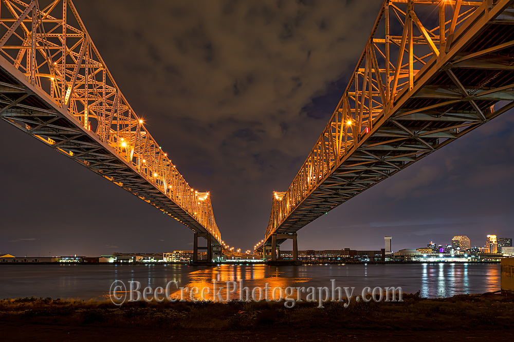 Mississippi river bridges in New Orleans or also called the Cresent bridge after dark.