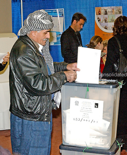 New Carrollton, MD - January 29, 2005 -- Ahmar Besefkr of Binghamton, New York, votes in the Iraqi election in New Carrollron, Maryland on January 29, 2005.  Mr. Besefkr is originally from Kurdistan, Iraq..Credit: Ron Sachs / CNP..(RESTRICTION: NO New York or New Jersey Newspapers or newspapers within a 75 mile radius of New York City)