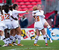 Alex Reed (7) of Maryland celebrates her goal with teammates during the game at Ludwig Field in College Park, MD.  Maryland defeated Miami, 2-1, in overtime.
