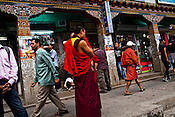 Buddhist Monks and other Bhutanese seen at the main market in Thimphu, Bhutan. Photo: Sanjit Das/Panos