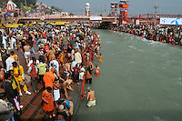 Hindu pilgrims taking  holy dip during the first Sahi Snan (Royal dip) at Kumbh mela on 12th February 2010. Haridwar, Uttara Khand, India, Arindam Mukherjee