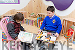 Enjoying a read at the 321 Kerry Down Syndrome  new book shop and coffee dock on Tuesday were Joshua M. Falvy and  Cian Heaslip