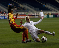 Kristine Lilly (13) of the USWNT tries to tackle the ball away from Li Danyang (14) of China during an international friendly at PPL Park in Chester, PA.  The U.S. tied China, 1-1.
