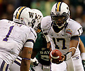 Washington's Keith Price (17) hands off to Chris Polk during game action against Baylor of the 2011 Valero Alamo Bowl at the Alamodome in San Antonio, Texas on Thursday, Dec. 29, 2011. Baylor won 67-56.