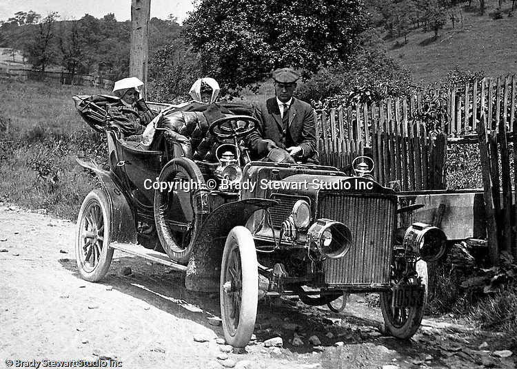 Product: Buick Model F<br /> Manufacturer: Buick Auto-Vim and Power Company,<br /> <br /> Westmoreland County PA:  Brady Stewart amd friends out for a drive on the Pittsburgh to Greensburg Turnpike. The women and men are all wearing &quot;motoring clothes&quot; for the trip.