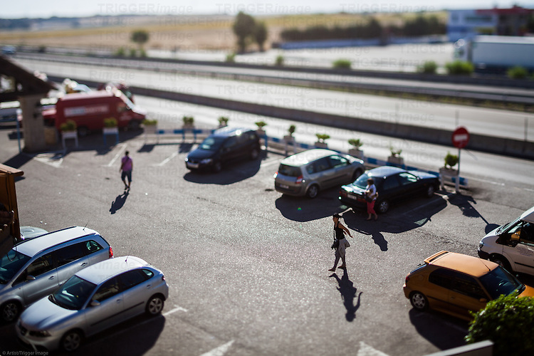 Parking lot by a highway, Guadalajara, Spain