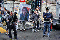 Roma 7  Maggio 2013.Il sindacato di polizia Coisp  ha manifestato davanti al Ministero di Grazia e Giustizia per chiedere l'applicazione dei domiciliari  per i  due colleghi pregiudicati per l'omicidio colposo di Federico Aldrovandi rimasti in carcere. Un gruppo di manifestanti si &egrave; contrapporsto al sit-in del Coisp mostrando  la foto  di Federico Aldrovandi morto.<br /> Rome, Italy. 7th May 2013 -- A group of protesters showing a photo of Federico Aldrovandi dead, scream on a megaphone and protest. -- The police union in Coisp demonstrated outside the Ministry of Justice to request the a house arrest for two police colleagues in the manslaughter of Federico Aldrovandi.