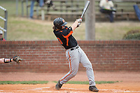 Austin Beck (23) of the North Davidson Knights follows through on his swing against the Alexander Central Cougars at Bob Gryder Stadium on March 25, 2017 in Taylorsville, North Carolina.  The Knights defeated the Cougars 3-0.  (Brian Westerholt/Four Seam Images)