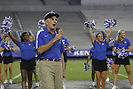 Announcer Carl Nathe speaks to the students at Big Blue U at Commonwealth Stadium on Saturday, August 18, 2012. Students were invited to come learn the cheers and fight song and then pose for a picture on the field. Photo by Tessa Lighty | Staff