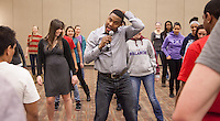 Motivational speaker Stan Pearson teaches students to Salsa dance. His presentation uses SALSA as an acronym for Supporting, Acting, Learning, Striving and Accepting.