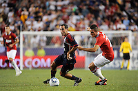 Nick LaBrocca (6) of the MLS All-Stars and Federico Macheda (27) of Manchester United. Manchester United defeated the MLS All-Stars 4-0 during the MLS ALL-Star game at Red Bull Arena in Harrison, NJ, on July 27, 2011.