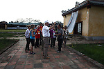 Tour guide Mr. Truc explains a bit of history to members of the Veterans for Peace tour inside the grounds of the Citadel in the former imperial capital of Hue, Vietnam. The group toured Vietnam in April to learn about efforts to mitigate the suffering of the country's Agent Orange victims and others who have been maimed by land mines and bombs left over from the war. April 21, 2013.