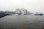 rainy day on the Ij behind  Amsterdam Central looking towards IJdok