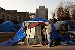 January 23, 2013. Durham, North Carolina. (left to right) Junaid Arefeen and Kenia McFadden, both freshmen, stand at their tent in K-Ville where students camp out to get tickets for home basketball games at Cameron Indoor Stadium. Students stay for weeks leading up to the game versus arch rival UNC.. Duke University has become a power house in the national college basketball arena under the coaching of head coach Mike Krzyzewski. But the university has fought hard to maintain its image of high academic achievement while riding the wave of collegiate athletic success.