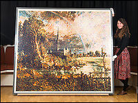 BNPS.co.uk (01202 558833)<br /> Pic: TomWren/BNPS<br /> <br /> Aspire trainee Nicola Trowell with the Lego Constable.<br /> <br /> Lego-lovers have recreated one of John Constable's most famous paintings with 65,000 tiny building blocks. <br /> <br /> The unusual replica of Constable's 1831 work 'Salisbury Cathedral from the Meadows' has been put together in celebration of the original's arrival at the Salisbury Museum in Wiltshire. <br /> <br /> About 800 volunteers flocked to the museum earlier this week to empty out the giant sacks of Lego and put the puzzle together