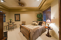 Quaint and elegant guest bedroom with dark brown armoire