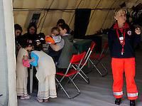 Roma 28 Febbraio 2009.Prima campagna di vaccinazione della Croce Rossa Italiana riguardante i bambini del campo nomadi Casilino 900, uno dei più grandi della Capitale..La compilazione della scheda sanitaria