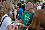 Incoming Ohio University freshman Hayden Clark participates in the Involvement Fair on the College Green on Aug. 24, 2014. Photo by Lauren Pond