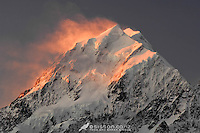 Wind blown snow on the summit of Aoraki / Mt Cook is illuminated at sunset