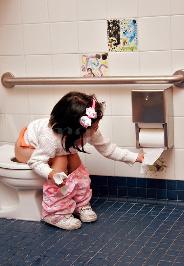 Preschooler using the potty.