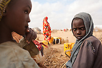Young girls and women wait to collect water from a water point in Ifo extention. UNHCR began moving families form the  self-settled areas at the outskirts of the camp to Ifo extention in July, 2011.  In Ifo extention it will be easier for  water, sanitation and security services to be delivered.