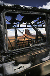 Rusting burned out bus in Monument Valley UT.