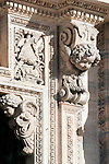The carved details of angels on the facade of the Duomo (Cathedral) in Milan, Italy.