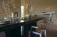 The sideboard and dining table in this dining room are fashioned out of painted, distressed steel and the fibre optic lights were designed by David Emery