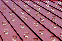 Small plastic reflectors on a wooden roof