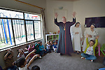 Cardinal Timothy Dolan, the archbishop of New York, visits with displaced children in a nursery run by the Dominican Sisters of St. Catherine of Siena in Ankawa, near Erbil, Iraq, on April 9, 2016. <br /> <br /> Dolan, a board member of the Catholic Near East Welfare Association, is in Iraqi Kurdistan with other church leaders to visit with Christians and others displaced by ISIS. The Dominican Sisters were themselves displaced by ISIS, and have established schools and other ministries among the displaced.<br /> <br /> CNEWA is a papal agency providing humanitarian and pastoral support to the church and people in the region.